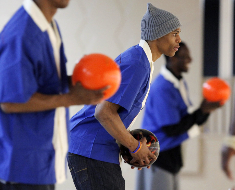 Photo - FUNDRAISER / FUNDRAISING / BENEFIT / CHARITY: Russell Westbrook of the Oklahoma City Thunder NBA basketball team prepares to bowl during the Russell Westbrook Celebrity Bowl event, benefitting the Oklahoma City Urban Youth Scholarship Fund, at Windsor Lanes in Oklahoma City, Saturday, March 27, 2010. Photo by Nate Billings, The Oklahoman ORG XMIT: KOD