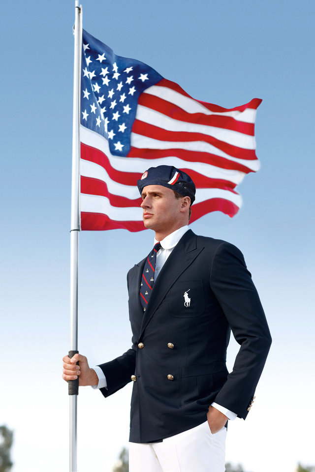 Photo - FILE - This product image released by Ralph Lauren shows U.S. Olympic swimmer Ryan Lochte modeling the the official Team USA Opening Ceremony Parade Uniform. Republicans and Democrats railed Thursday,  July 12, 2012, about the U.S. Olympic Committee's decision to dress the U.S. team in Chinese manufactured berets, blazers and pants while the American textile industry struggles economically with many U.S. workers desperate for jobs. (AP Photo/Ralph Lauren, File) ORG XMIT: NYET978