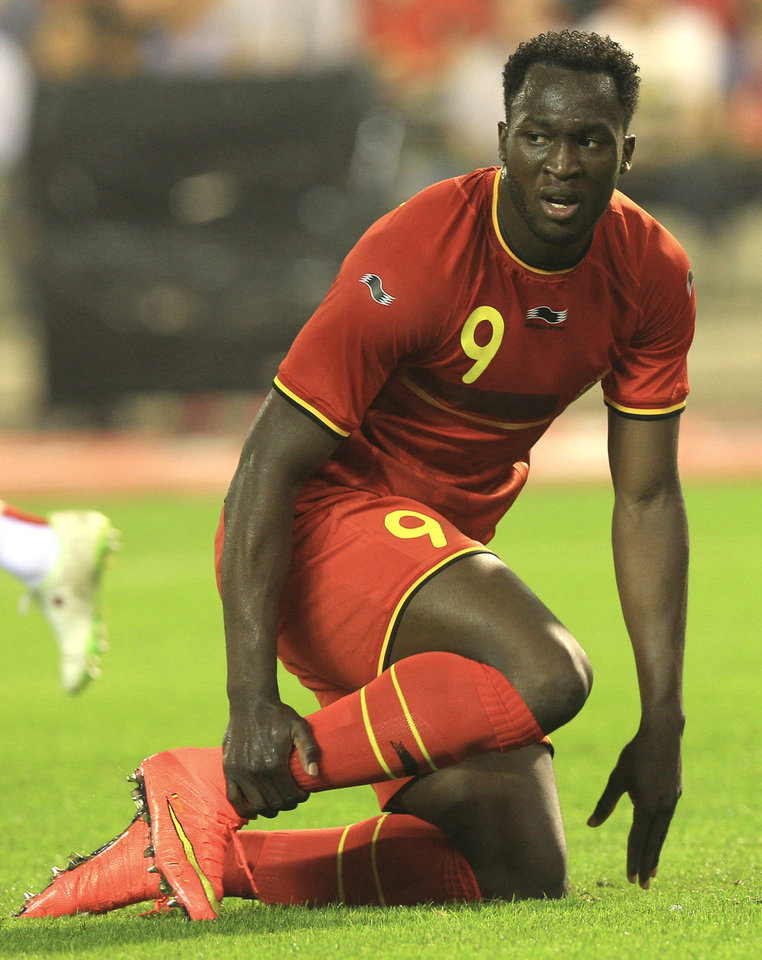 Photo - Belgium's Romelu Lukaku touches his ankle during a friendly soccer match against Tunisia, at the King Baudouin stadium in Brussels, Saturday, June 7, 2014. Belgium will play against South Korea, Russia and Algeria in Group H of the World Cup 2014 in Brazil. (AP Photo/Yves Logghe)