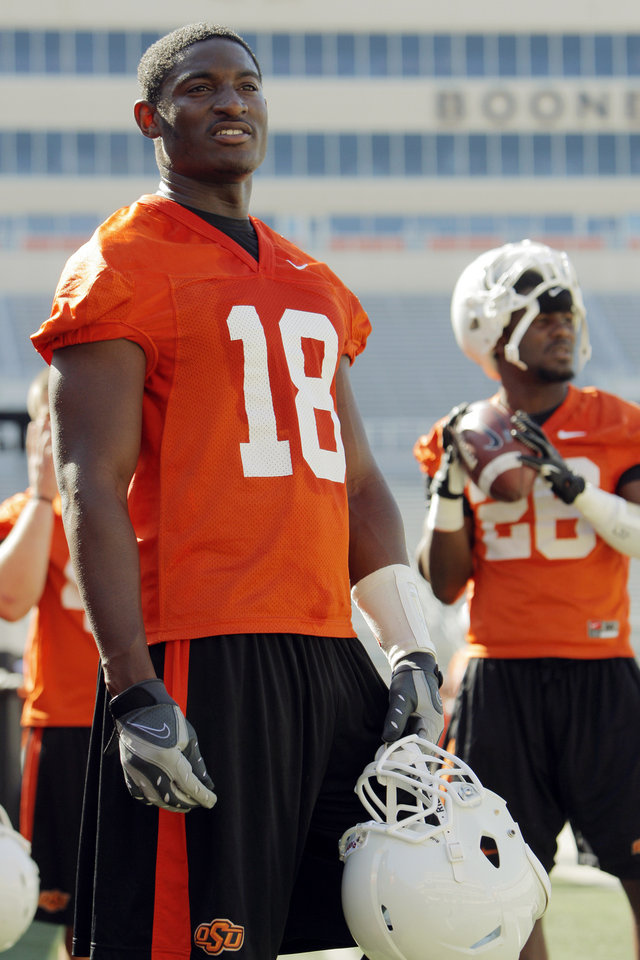 Photo - Blake Jackson (18) stands on the sideline during OSU spring football practice at Boone Pickens Stadium on the campus of Oklahoma State University in Stillwater, Okla., Monday, March 12, 2012. At right in the background is DeShawn Franklin (28). Photo by Nate Billings, The Oklahoman