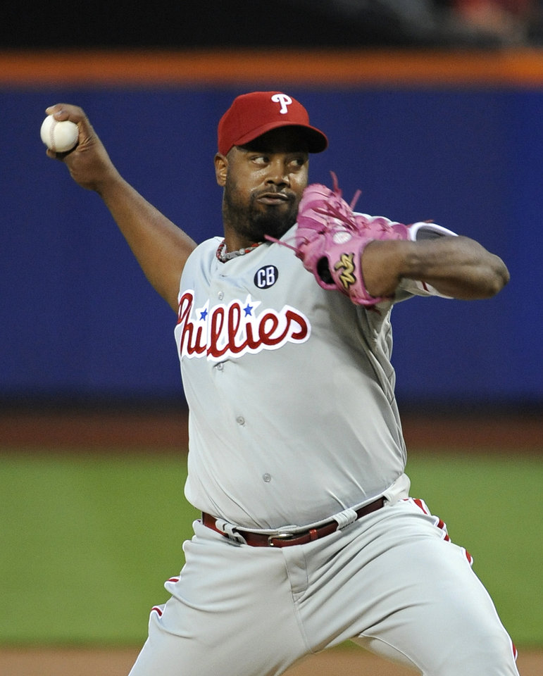 Photo - Philadelphia Phillies starter Jerome Williams pitches against the New York Mets in the first inning of a baseball game at Citi Field on Saturday, Aug. 30, 2014, in New York. (AP Photo/Kathy Kmonicek)