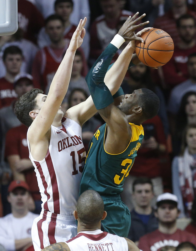 Photo - Oklahoma forward Tyler Neal (15) blocks a shot by Baylor forward Cory Jefferson (34) in the second half of an NCAA college basketball game in Norman, Okla., Saturday, Feb. 8, 2014. Oklahoma won 88-72. (AP Photo/Sue Ogrocki)