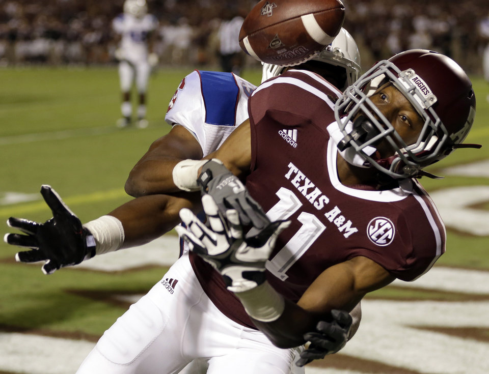 Texas A&M wide receiver Derel Walker (11) can't hang onto a pass in the end zone as South Carolina State defensive back Steven Murphy defends during the third quarter of an NCAA college football game Saturday, Sept. 22, 2012, in College Station, Texas. (AP Photo/David J. Phillip)