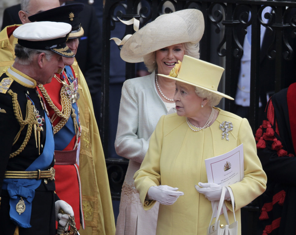 Photo - Britain's Queen Elizabeth II chats with Camilla, Duchess of Cornwall, Britain's Prince Philip and Britain's Prince Charles, from right, as they leave Westminster Abbey at the Royal Wedding in London Friday, April, 29, 2011. (AP Photo/Gero Breloer)  ORG XMIT: RWFO152