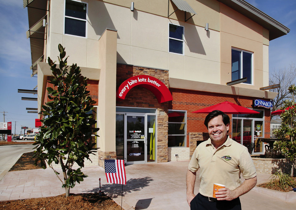 "Schlotzsky's franchisee David Jones outside his new Midwest City location. His property includes upscale apartments above the eatery, part of Midwest City's ""Original Mile"" revitalization. <strong>Jim Beckel - THE OKLAHOMAN</strong>"