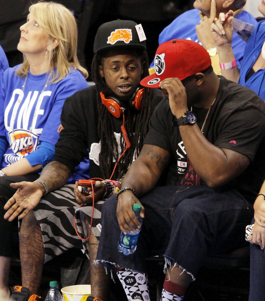 Rapper Lil Wayne, middle, sits courtside during Game 1 of the NBA Finals between the Oklahoma City Thunder and the Miami Heat at Chesapeake Energy Arena in Oklahoma City, Tuesday, June 12, 2012. Oklahoma City won, 105-94. Photo by Nate Billings, The Oklahoman