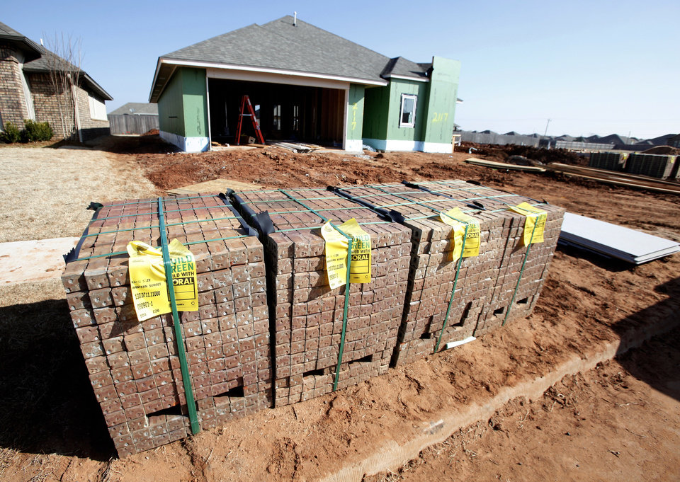 Photo - JEFF CLICK HOMES / HOUSE CONSTRUCTION: Brick stacked at 2117 NW 172 under construction in Oklahoma City Thursday, March 18, 2010. Photo by Paul B. Southerland, The Oklahoman ORG XMIT: KOD