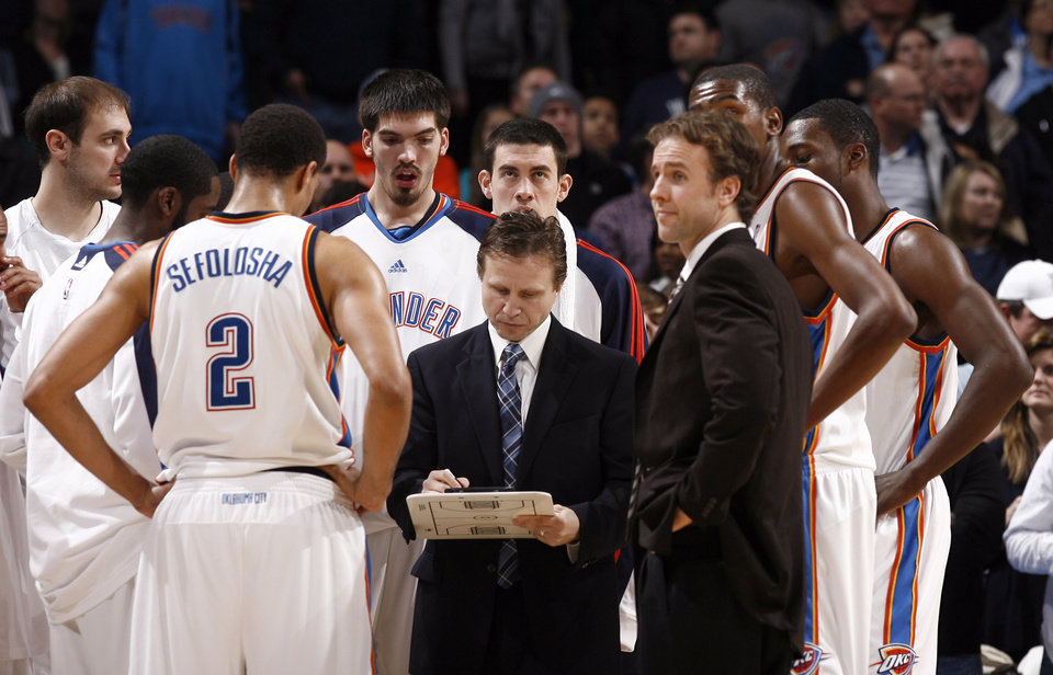 Photo - Oklahoma City head coach Scott Brooks leads a time out during the NBA game between the Oklahoma City Thunder and Golden State Warriors, Sunday, Jan. 31, 2010, at the Ford Center in Oklahoma City. Photo by Sarah Phipps, The Oklahoman