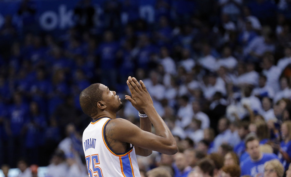Photo - Oklahoma City's Kevin Durant (35) says a prayer before entering the game during Game 2 in the first round of the NBA playoffs between the Oklahoma City Thunder and the Houston Rockets at Chesapeake Energy Arena in Oklahoma City, Wednesday, April 24, 2013. Photo by Chris Landsberger, The Oklahoman