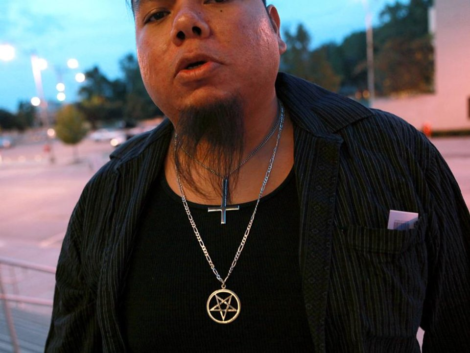 Eddie Harjo shows his necklaces as he enters the Civic Center Music Hall to attend a satanic demonstration by members of the Church of the IV Majesties at the Civic Center Music Hall in downtown Oklahoma City on Thursday, Oct. 21, 2010. Photo by John Clanton, The Oklahoman