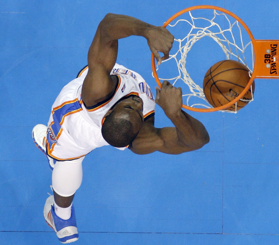 Photo - Oklahoma City 's Serge Ibaka (9) dunks the ball during the NBA game between the Oklahoma City Thunder and the Los  Angeles Clippers at the Chesapeake Energy Arena, Sunday, Feb. 23, 2014. Photo by Sarah Phipps, The Oklahoman