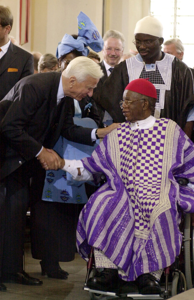 Photo - FILE - In this Oct. 13, 2002 file photo, Richard von Weizaecker, left, former German President, congratulates Nigerian author Chinua Achebe, after Achebe was awarded the prestigious Peace Prize of the German publishing industry at the Paul's Church in Frankfurt Main, Germany. Achebe, who wrote the classic,