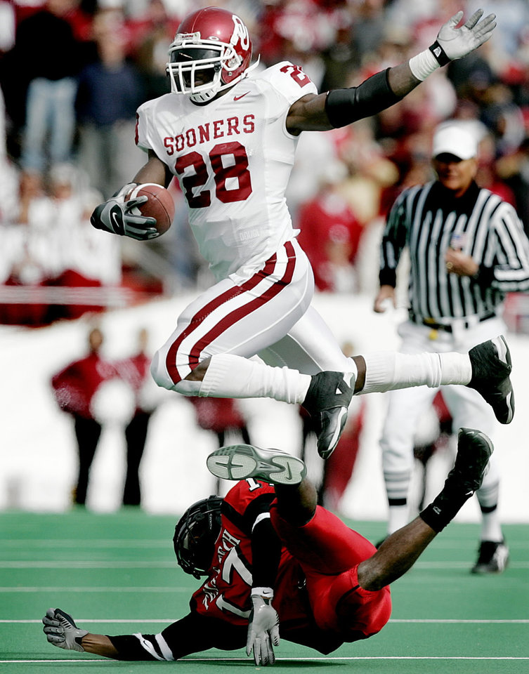 Adrian Peterson of OU leaps over Chris Parker of Texas Tech during the University of Oklahoma Sooners (OU) college football game against Texas Tech, at Jones SBC Stadium, Saturday, November 19, 2005, in Lubbock, Texas. by Bryan Terry/The Oklahoman