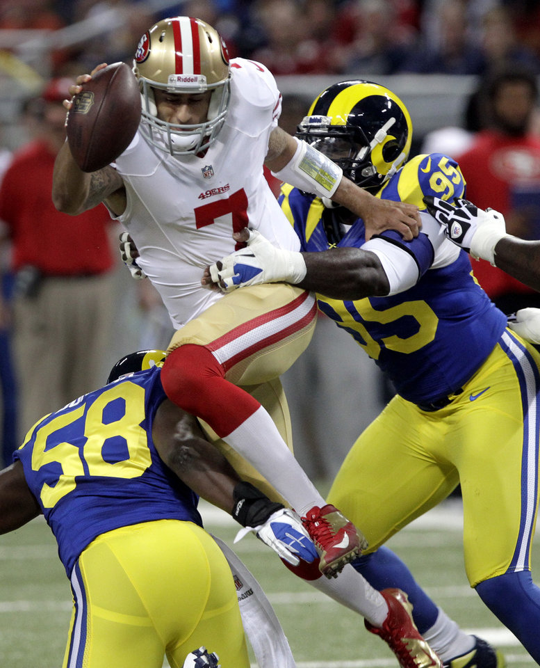 San Francisco 49ers quarterback Colin Kaepernick is sacked for a 7-yard loss by St. Louis Rams outside linebacker Jo-Lonn Dunbar (58) and defensive end William Hayes, right, during the first quarter of an NFL football game Sunday, Dec. 2, 2012, in St. Louis. (AP Photo/Seth Perlman)