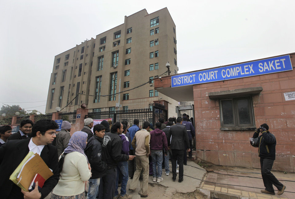 Photo - Indians stand in a queue to enter the District Court complex where a new fast-track court was inaugurated Wednesday to deal specifically with crimes against women, in New Delhi, India, Thursday, Jan. 3, 2013. Indian police were preparing Thursday to file rape and murder charges against a group of men accused of sexually assaulting a 23-year-old university student for hours on a moving bus in New Delhi. The Dec. 16 attack on the woman, who later died of her injuries, has caused outrage across India, sparking protests and demands for tough new rape laws, better police protection for women and a sustained campaign to change society's views about women. (AP Photo/ Manish Swarup)