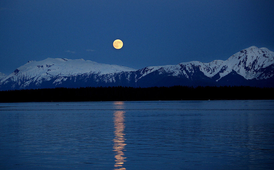 A full moon rises over a mountain range in Alaska, Sunday, June 3, 2012.  Photo by Sarah Phipps, The Oklahoman