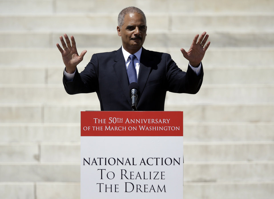 "ADDING SECOND SENTENCE TO CAPTION - Attorney General Eric Holder acknowledges applause before speaking at a rally to commemorate the 50th anniversary of the 1963 March on Washington on the steps of the Lincoln Memorial in Washington Saturday, Aug. 24, 2013. Holder, the nation's first black attorney general, said he would not be in office, nor would Barack Obama be president, without those who marched. ""They marched in spite of animosity, oppression and brutality because they believed in the greatness of what this nation could become and despaired of the founding promises not kept,"" Holder said. (AP Photo/Carolyn Kaster)"