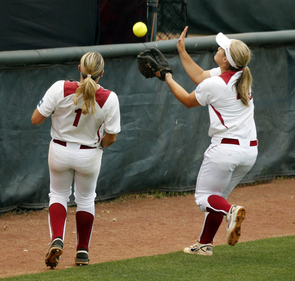 Photo - Oklahoma's Georgia Casey bobbles and drops a pop up fly with two outs as the University of Oklahoma Sooner (OU) softball team plays Tennessee in the first game of the NCAA super regional at Marita Hynes Field on May 23, 2014 in Norman, Okla. Photo by Steve Sisney, The Oklahoman