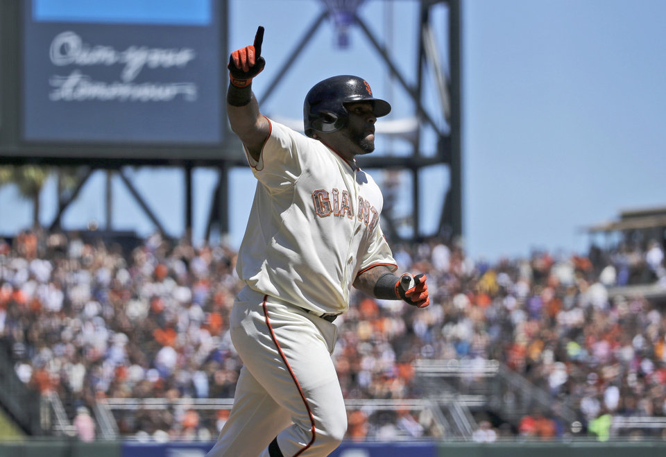 Photo - San Francisco Giants' Pablo Sandoval celebrates his two-run home run against the Chicago Cubs during the fourth inning of a baseball game on Monday, May 26, 2014, in San Francisco. (AP Photo/Marcio Jose Sanchez)