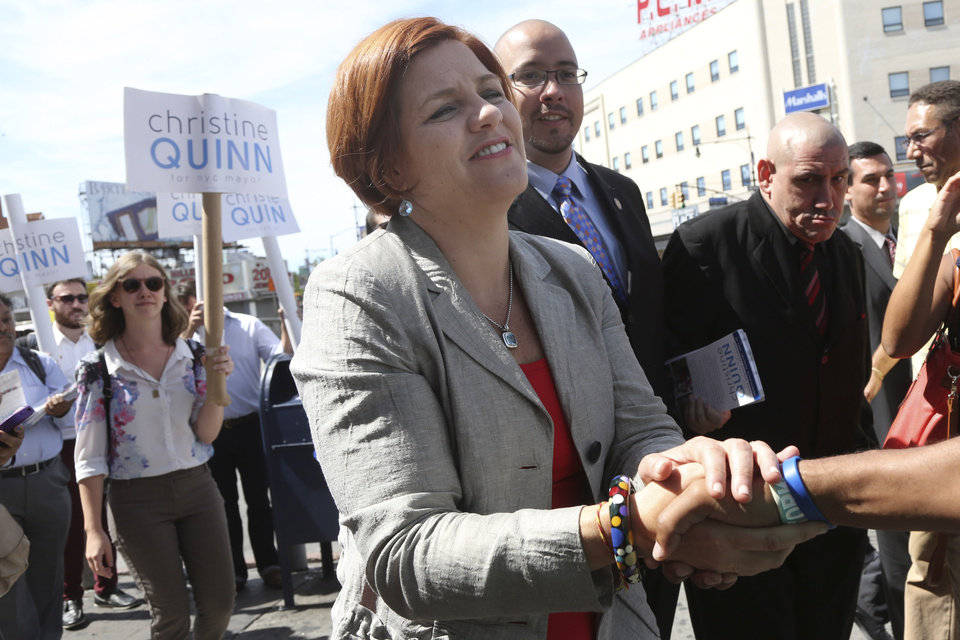 Photo - New York City Democratic mayoral hopeful and City Council Speaker Christine Quinn greets a voter during a campaign stop in the Bronx borough of New York, Thursday, Sept. 5, 2013.  The Democratic primary election is Tuesday, Sept. 10. (AP Photo/Mary Altaffer)