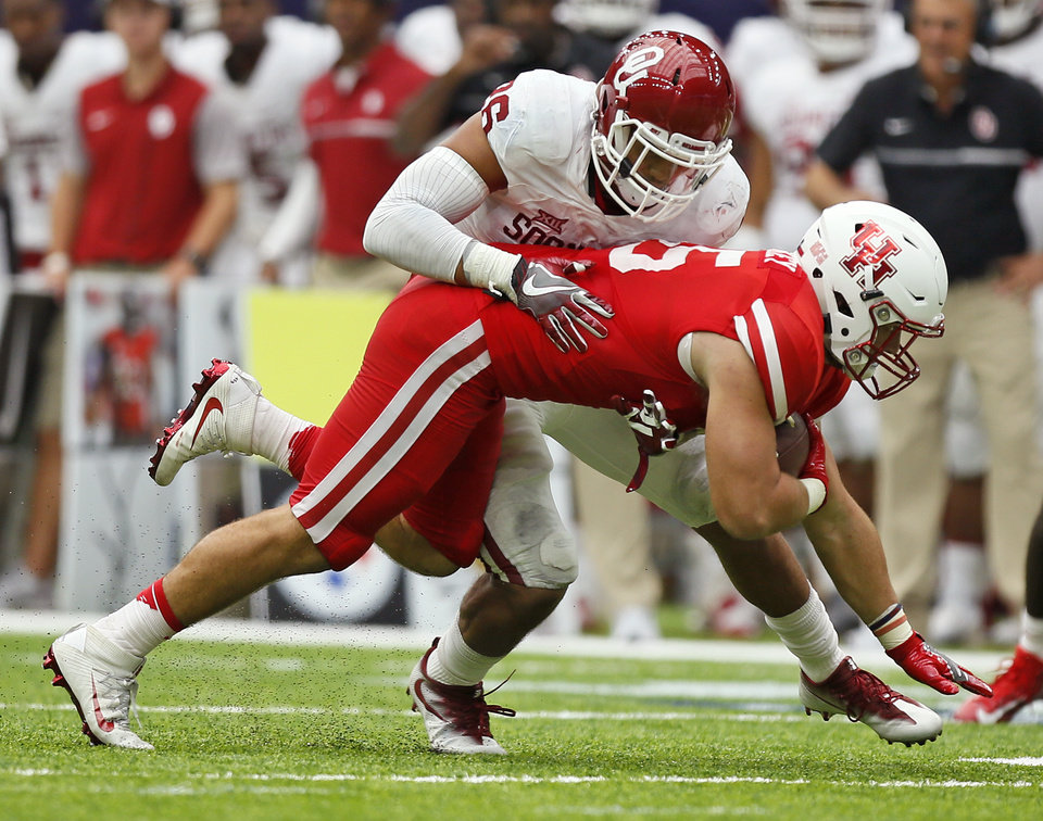 Photo - Jordan Evans (26) tackles Houston's Tyler McCloskey (45) after a catch tduring the AdvoCare Texas Kickoff college football game between the University of Oklahoma Sooners (OU) and the Houston Cougars at NRG Stadium in Houston, Saturday, Sept. 3, 2016. Houston won 33-23. Photo by Nate Billings, The Oklahoman