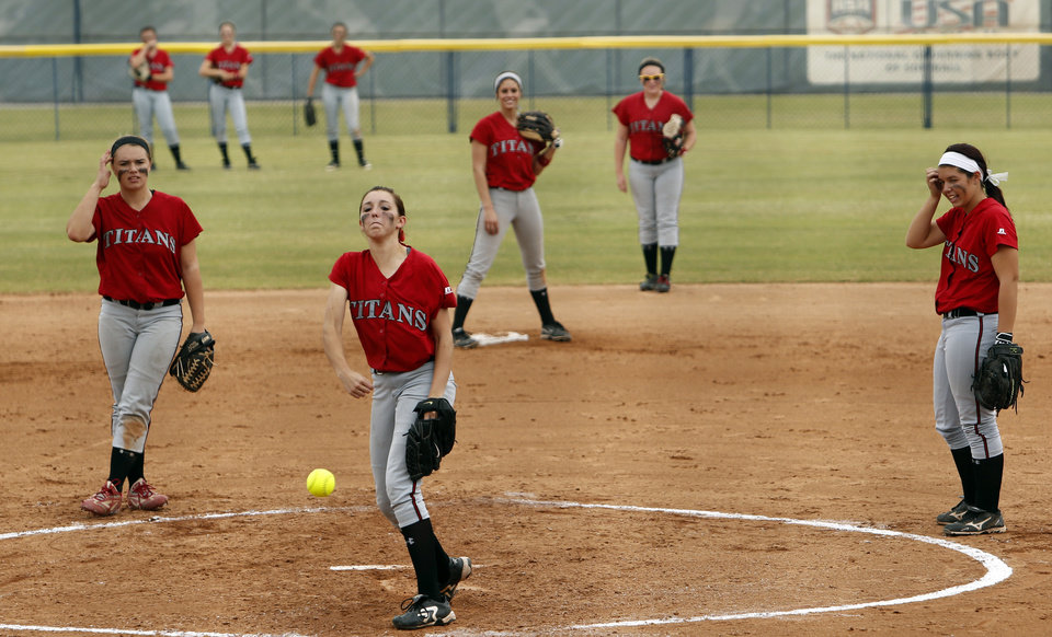 Photo - Carl Albert pitcher Abby Meador warms up as the Titans play Collinsville at the 2012 State Fast-Pitch Softball Tournament on Thursday, Oct. 11, 2012 at ASA Hall of Stadium in Oklahoma City, Okla.  Photo by Steve Sisney, The Oklahoman