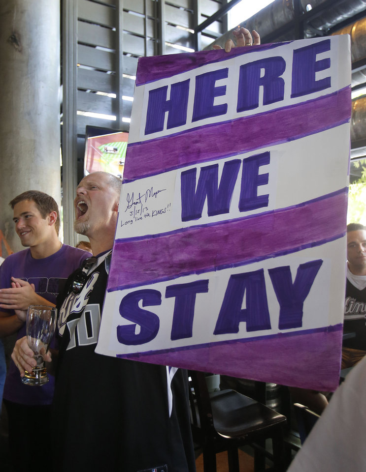 Photo - Sacramento Kings fan Chris Haskins celebrates with other Kings fans over the news that the NBA has rejected the proposed move of the team to Seattle during a celebration in Sacramento, Calif., Wednesday, May 15, 2013. A group led by investor Chris Hansen had a deal to buy the team from the Maloof family and move the Kings but NBA owners followed the recommendation made last month by the NBA's relocation committee and voted 22-8 against moving the team to Seattle. (AP Photo/Rich Pedroncelli)