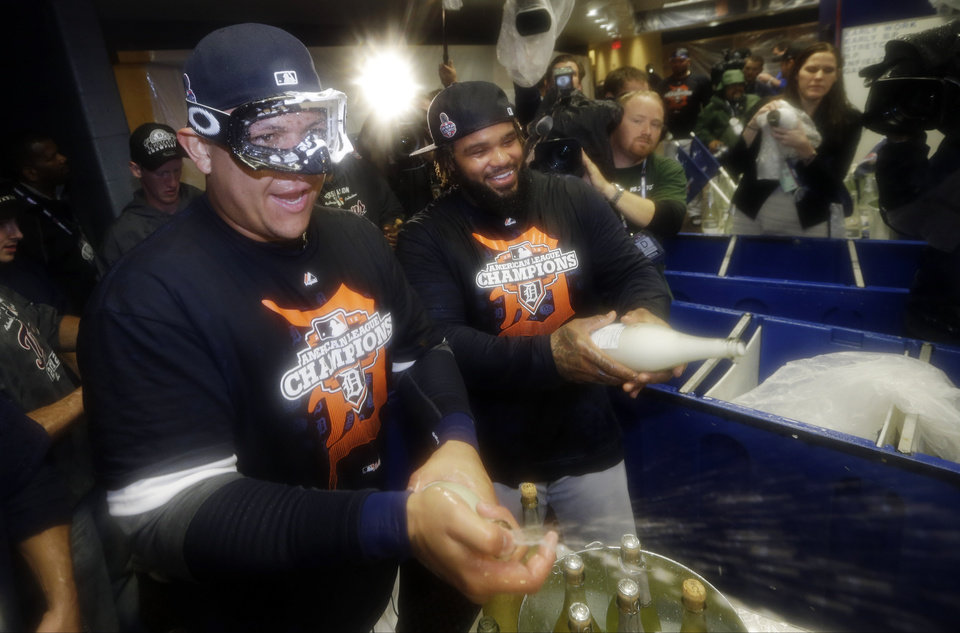 Photo -   Detroit Tigers' Miguel Cabrera, left, and Prince Fielder, right, celebrate in the locker room after their team won Game 4 of the American League championship series 8-1, against the New York Yankees, Thursday, Oct. 18, 2012, in Detroit. The Tigers move on to the World Series. (AP Photo/Paul Sancya)