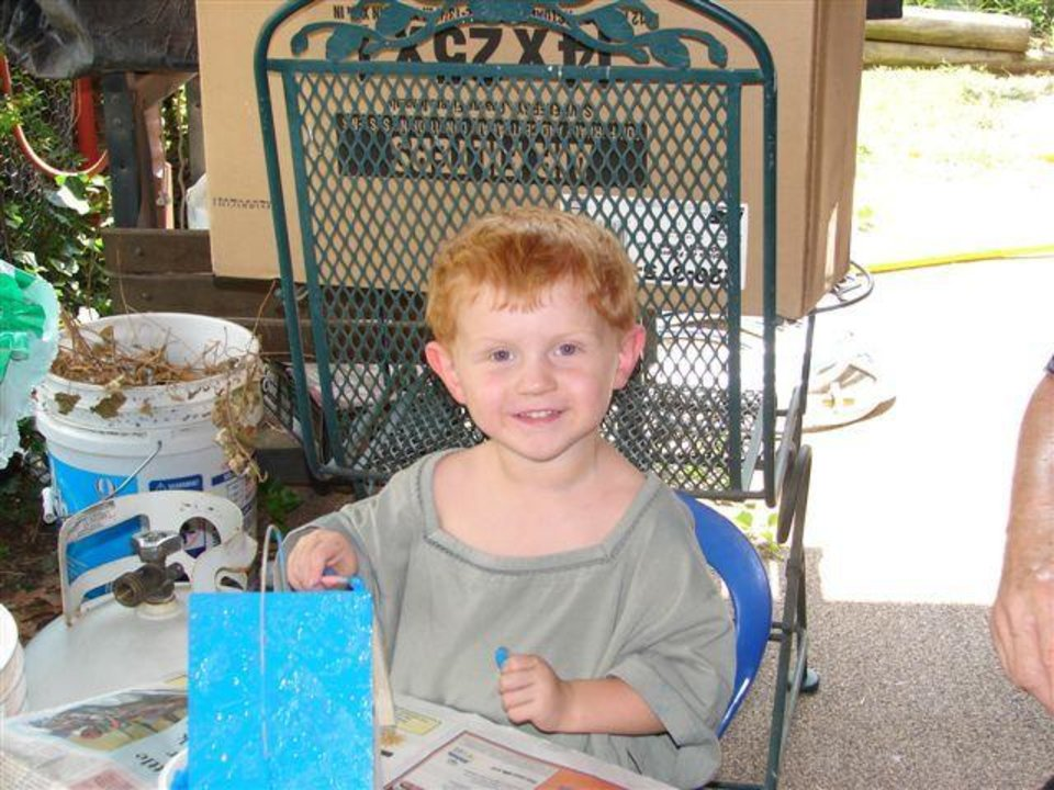 Painting a birdhouse while mom and dad are at the OU football game. (crafty grandma) Community Photo By: Harry Holmes Submitted By: Lindsay, Edmond