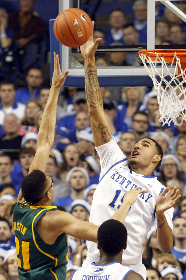 Photo - Kentucky's Willie Cauley-Stein, right, blocks the shot of Baylor's Isaiah Austin during the first half of an NCAA college basketball game at Rupp Arena in Lexington, Ky., Saturday, Dec. 1, 2012. (AP Photo/James Crisp)