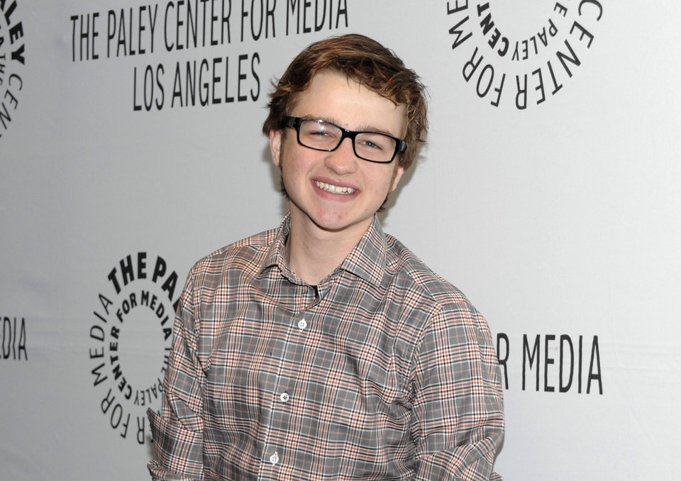 "FILE - In this March 12, 2012 file photo, actor Angus T. Jones arrives at the Paleyfest panel discussion of the television series ""Two and a Half Men"" in Beverly Hills, Calif. Jones, the teenage actor who plays the half in the hit CBS comedy ""Two and a Half Men"" says it's ""filth"" and through a video posted by a Christian church has urged viewers not to watch it. (AP Photo/Dan Steinberg, File)"