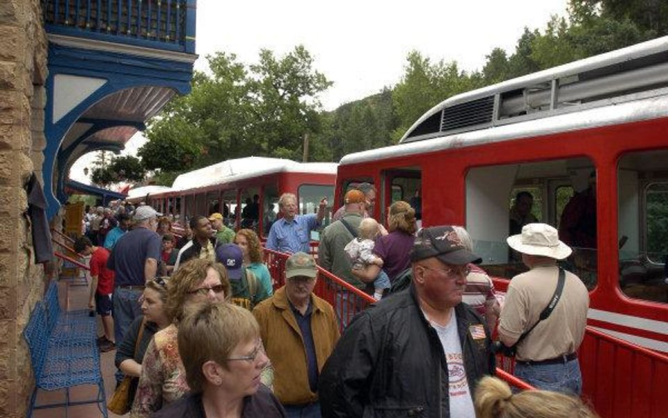 ** ADVANCE FOR WEEKEND EDITIONS APRIL 25-26 ** *In this file photograph taken on Tuesday, July 10, 2007, passengers board the Pikes Peak Cog Railway in Manitou Springs, Colo. (AP Photo/The Gazette, Carol Lawrence, file) ORG XMIT: COCOL701