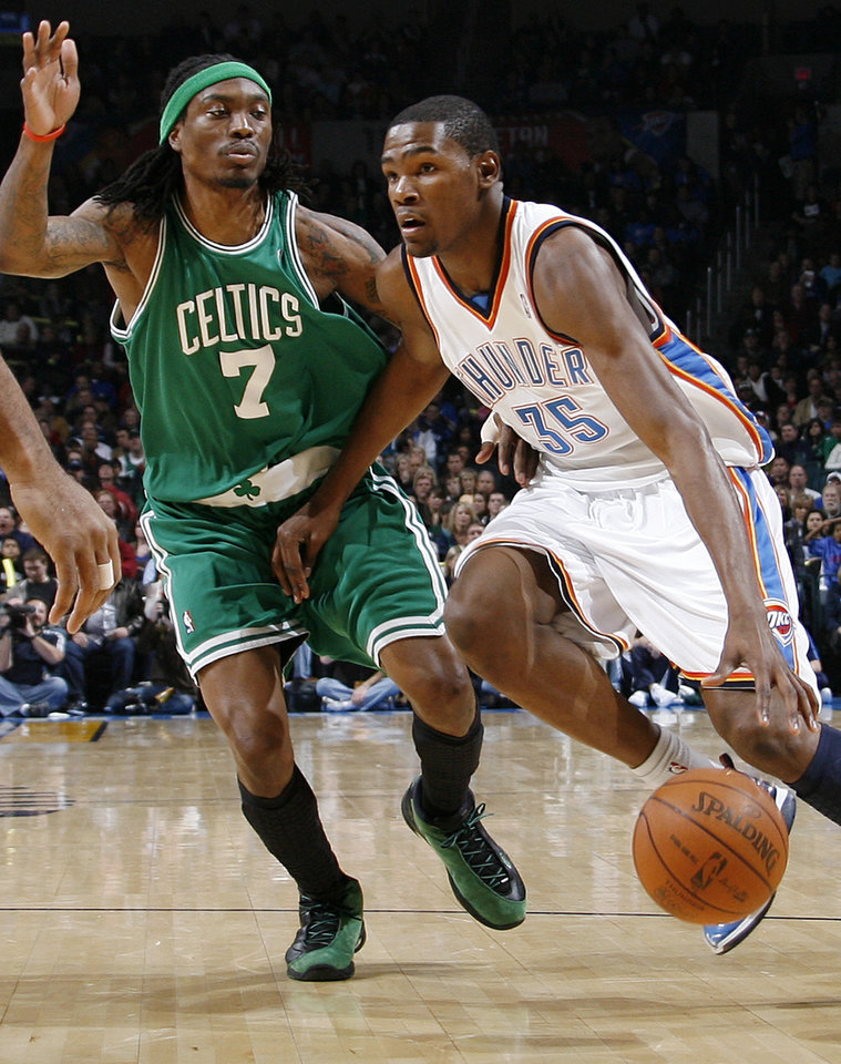 Photo - Oklahoma City's Kevin Durant (35) drives past Marquis Daniels (7) of Boston in the first half of the NBA basketball game between the Boston Celtics and the Oklahoma City Thunder at the Ford Center in Oklahoma City, Friday, Dec. 4, 2009. Photo by Nate Billings, The Oklahoman ORG XMIT: KOD