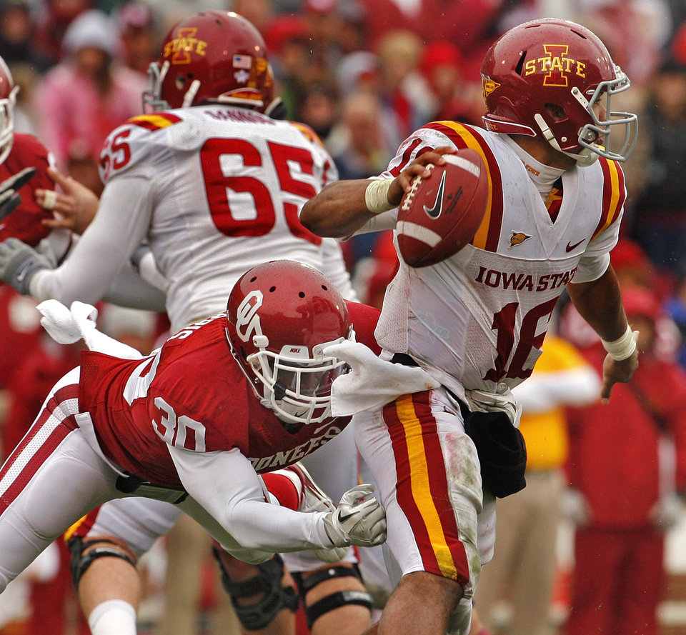 Oklahoma's Javon Harris (30) hurries a pass by Iowa State's Jared Barnett (16)during the second half of a college football game in which  the University of Oklahoma Sooners (OU) defeated the Iowa State University Cyclones (ISU) 26-6 at Gaylord Family-Oklahoma Memorial Stadium in Norman, Okla., Saturday, Nov. 26, 2011. Photo by Steve Sinsey, The Oklahoman