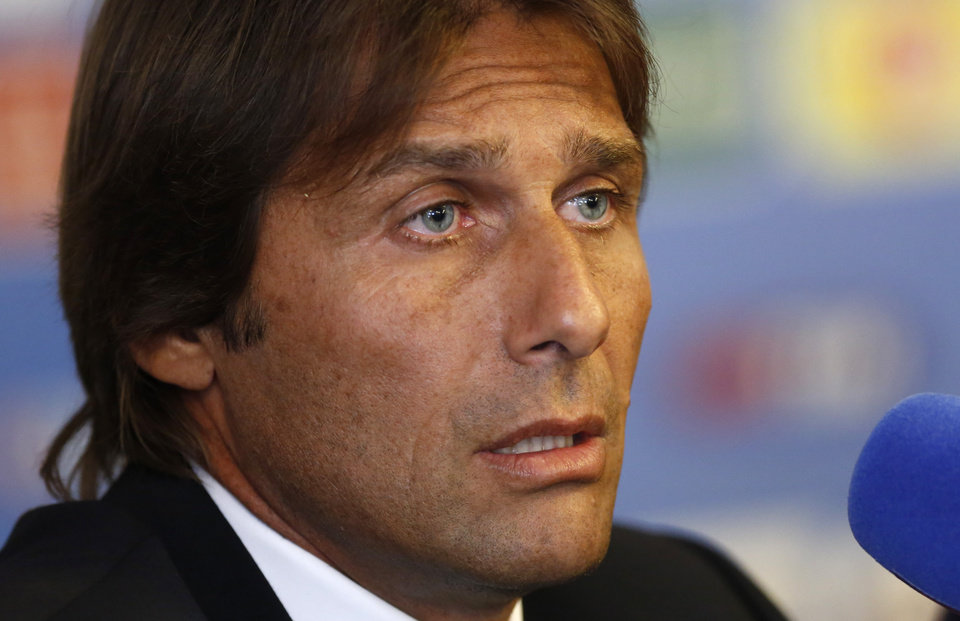 Photo - Italian national soccer team's new coach Antonio Conte speaks during a press conference for his presentation, in Rome, Tuesday, Aug. 19, 2014. (AP Photo/Riccardo De Luca)