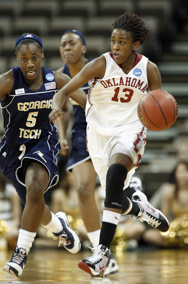 Photo - Danielle Robinson dribbles past Metra Walthour (5) on a fast break in the second half as the University of Oklahoma (OU) plays Georgia Tech in round two of the 2009 NCAA Division I Women's Basketball Tournament at Carver-Hawkeye Arena at the University of Iowa in Iowa City, IA on Tuesday, March 24, 2009. 