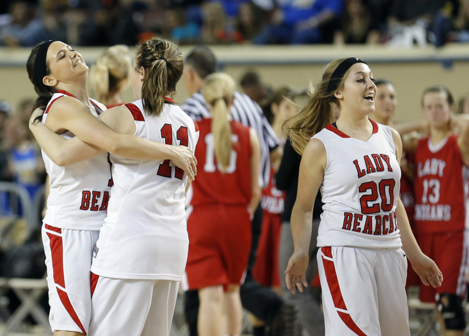 From left  to right, Erick's Kelsey Brinkley,  Maranda Janz, Savannah Osmond celebrate during the Class B Girls semifinal game of the state high school basketball tournament between Erick and Shattuck  at the State Fair Arena., Friday, March 1, 2013. Photo by Sarah Phipps, The Oklahoman