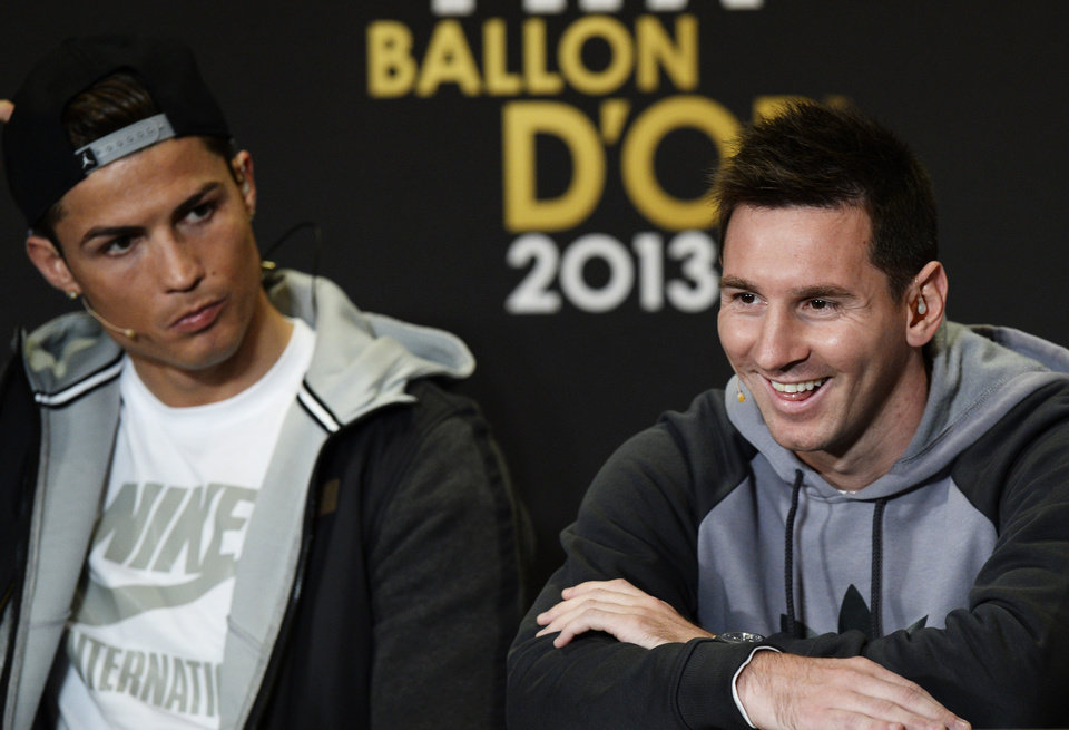 Photo - Cristiano Ronaldo of Portugal, left, and Lionel Messi of Argentina, right, nominees for the Men's World Soccer Player of the year, answer journalists questions during a press conference at the FIFA Ballon d'Or awarding ceremony  in Zurich, Switzerland, Monday, Jan. 13, 2014. (AP Photo/Keystone,Steffen Schmidt)
