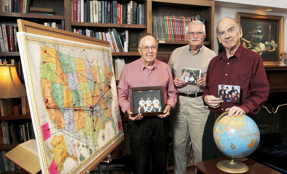 Three men who participated in a mapping project are, from left, William Rodgers, Darryl Woodson and William Bennett. Push pins and string represent the hometowns of children and grandchildren of residents at the Fountains at Canterbury.  Photo  by Jim Beckel, The Oklahoman. <strong>Jim Beckel - THE OKLAHOMAN</strong>