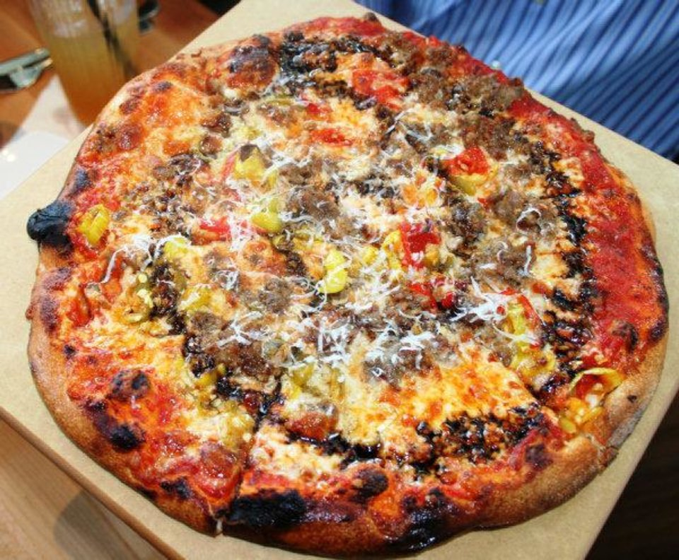 Photo - Some Like It Hot is just one of the many  pizzas offered at Upper Crust Wood-Fired Pizza in Classen Curve. Photo by Dave Cathey.