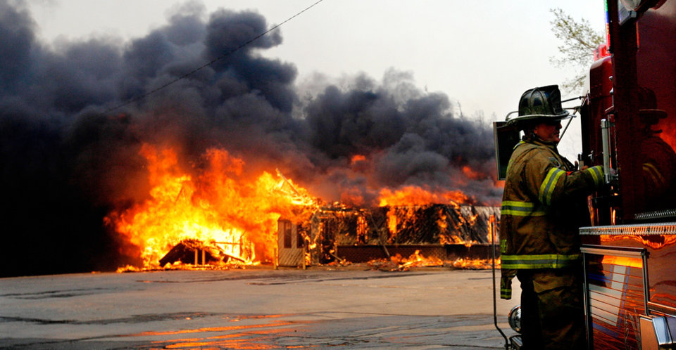 Photo - Tobacco store on NE 23 burned to the ground despite the efforts of Deer Creek firefighters Friday, March 11, 2011. Photo by Jim Beckel, The Oklahoman