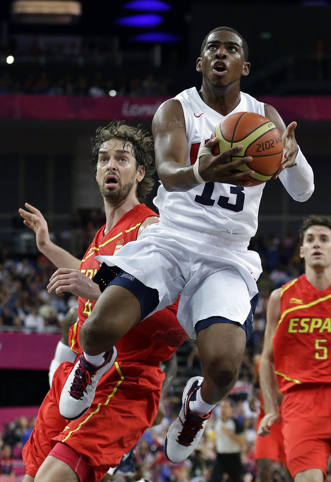 United States' Chris Paul drives past Spain's Pau Gasol during a men's gold medal basketball game at the 2012 Summer Olympics, Sunday, Aug. 12, 2012, in London. (AP Photo/Eric Gay)
