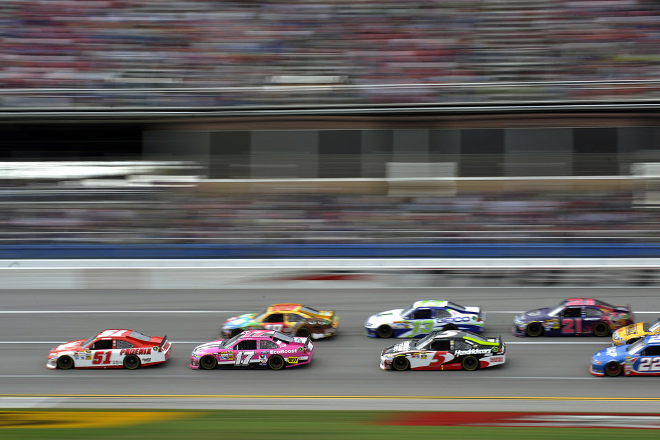 Kurt Busch (51) leads Matt Kenseth (17), Kyle Busch (18), Casey Mears (13), Kasey Kahne (5), Trevor Bayne (21) and Sam Hornish Jr., (22) during the NASCAR Sprint Cup Series auto race at Talladega Superspeedway in Talladega, Ala., Sunday, Oct. 7, 2012. (AP Photo/Rainier Ehrhardt)