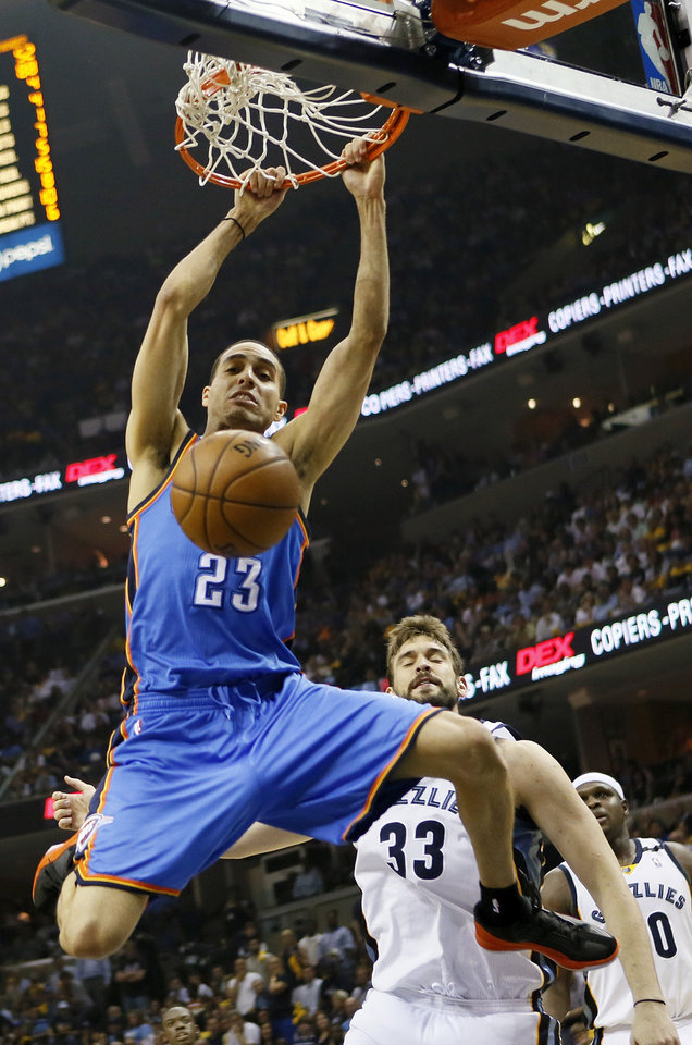 Oklahoma City\'s Kevin Martin (23) dunks the ball in front of Memphis\' Marc Gasol (33) and Zach Randolph (50) in the first half during Game 4 of the second-round NBA basketball playoff series between the Oklahoma City Thunder and the Memphis Grizzlies at FedExForum in Memphis, Tenn., Monday, May 13, 2013. Photo by Nate Billings, The Oklahoman