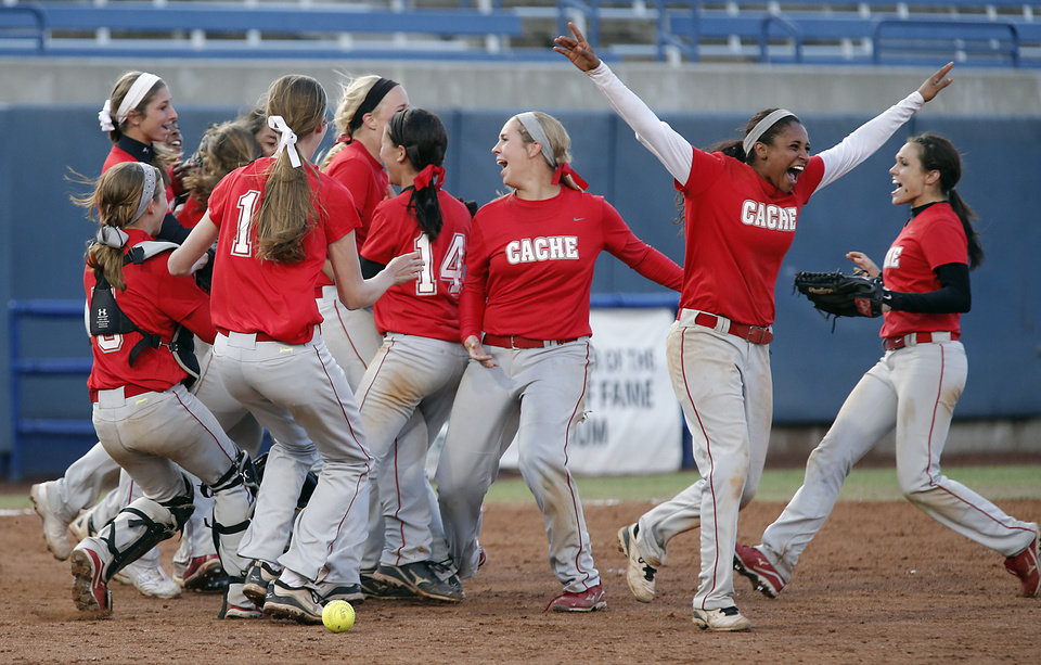 Photo - Cache celebrates the win over Henryetta in the Class 4A Oklahoma State High School Slow Pitch Softball Championship at ASA Hall of Fame Stadium in Oklahoma City, Wednesday, May 1, 2013. Photo by Chris Landsberger, The Oklahoman