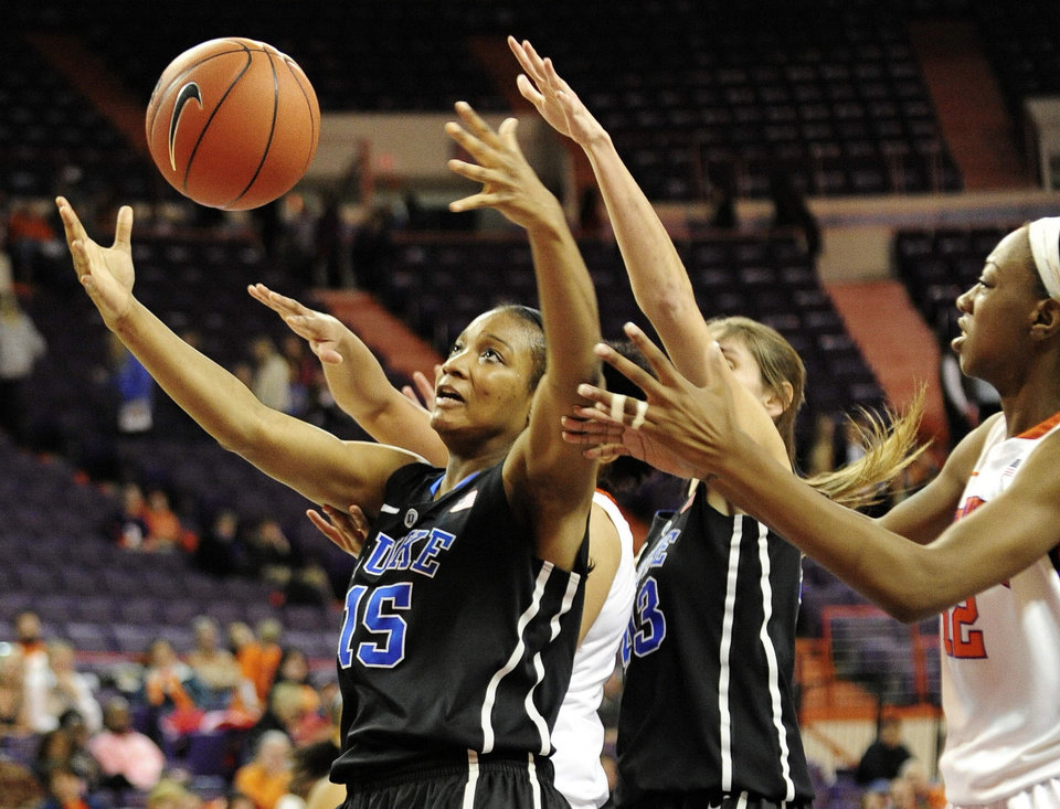 Duke's Richa Jackson, left, reaches for a loose ball during the second half of an NCAA college basketball game against Clemson, Thursday, Jan. 24, 2013, at Littlejohn Coliseum in Clemson, S.C. Duke won 60-46. (AP Photo/Richard Shiro)