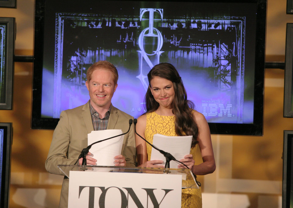 Photo - Actor Jesse Tyler Ferguson, left, and actress Sutton Foster, right, appear on stage at the 67th Annual Tony Award Nominations announcement on Tuesday April, 30, 2013 in New York. (Photo by Andy Kropa/Invision/AP)