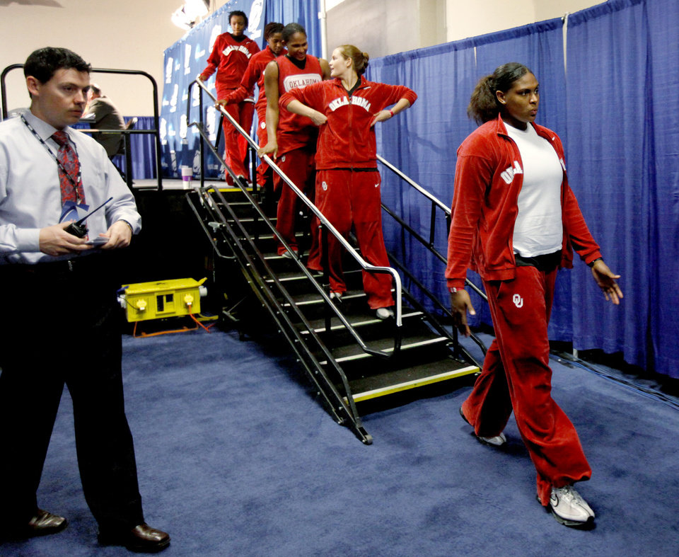OU's Courtney Paris walks off the stage after a news conference the day before the NCAA women's basketball tournament game between Oklahoma and Purdue at the Ford Center in Oklahoma City, Monday, March 30, 2009.  PHOTO BY BRYAN TERRY, THE OKLAHOMAN