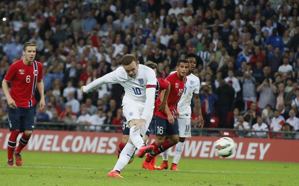 Photo - England's Wayne Rooney shoots and scores from the penalty spot during the international friendly soccer match between England and Norway at Wembley Stadium in London, Wednesday, Sept. 3, 2014. (AP Photo/Alastair Grant)