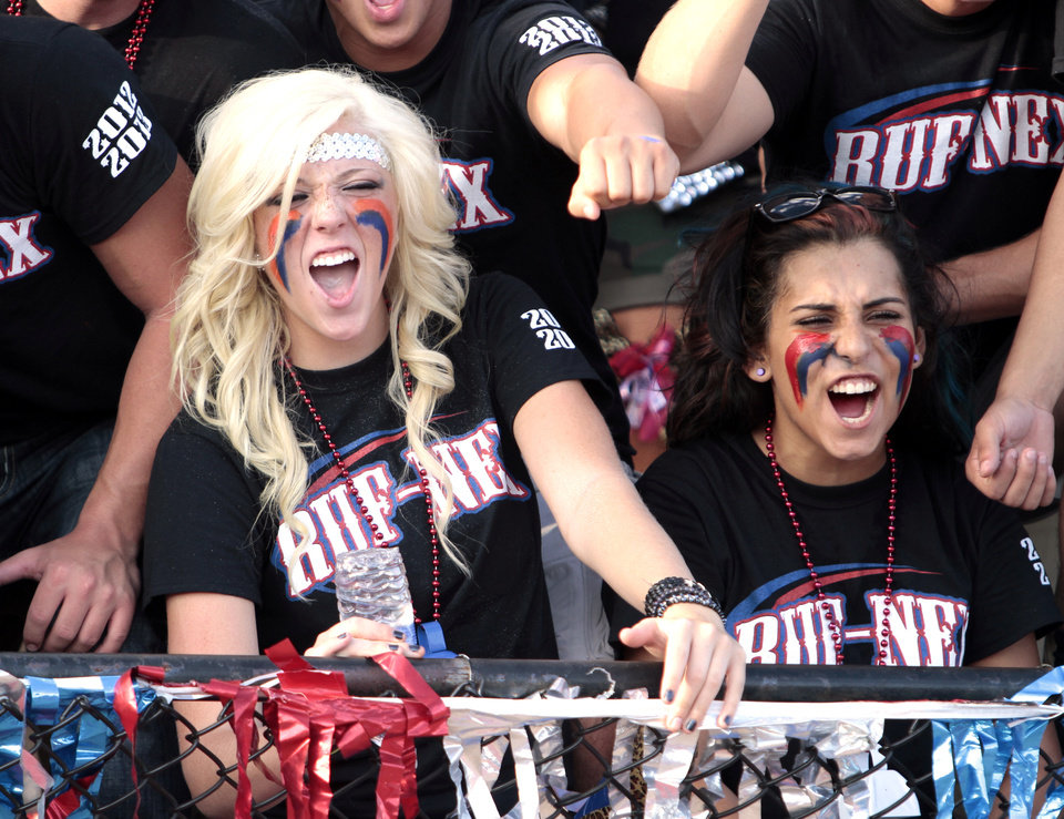 Photo - Moore fans Morgan Lechus and Gabby Schwartzkopf yell as The Moore Lions play the Westmoore Jaguars in high school football on Friday, Aug. 31, 2012 in Moore, Okla.  Photo by Steve Sisney, The Oklahoman